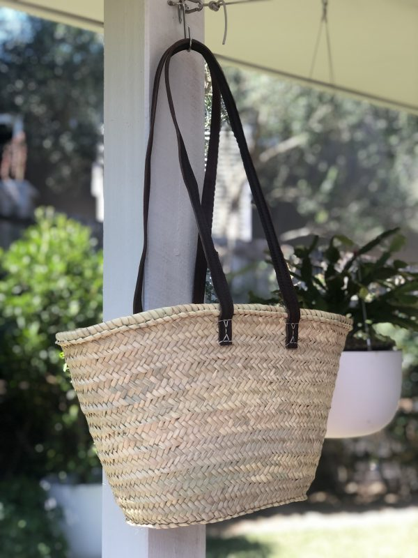 Small basket with long handles hanging on a hook