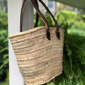 Handwoven basket with long leather handles
