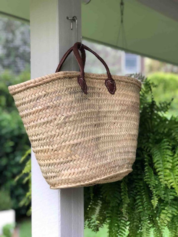 Handwoven basket with short leather handles