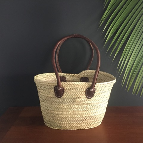 Small handwoven basket with long handles