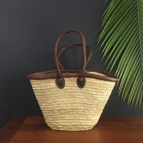 Hand woven basket sitting on a side table