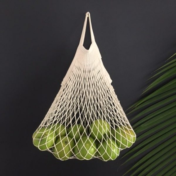 String bag with green apples