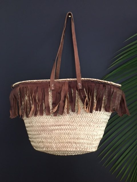 Basket with brown leather fringing