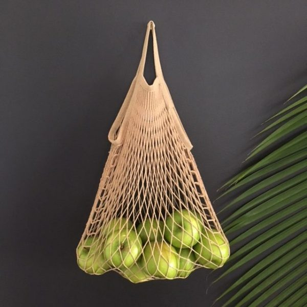 String bag with green green apples
