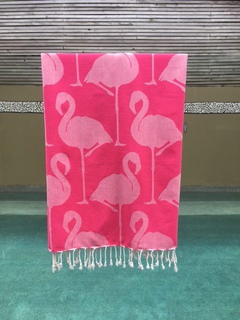 Pink flamingo towel by the pool