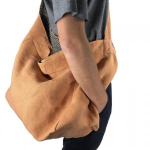 Man with carry bag of his shoulder