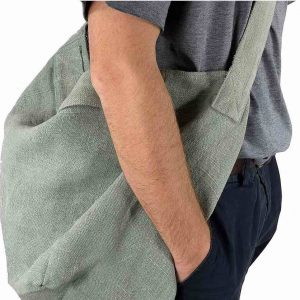 Man with carry bag over his shoulder