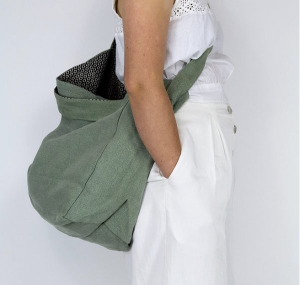 Woman with shopping bag over her shoulder