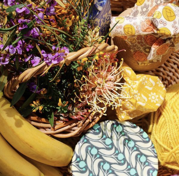Basket with Bee Eco Food Wraps covering bowls of food